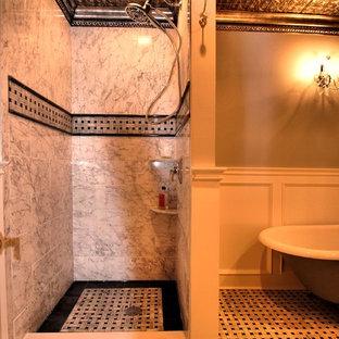 Imagen de cuarto de baño principal, clásico, de tamaño medio, con lavabo sobreencimera, armarios tipo mueble, puertas de armario de madera oscura, encimera de granito, bañera con patas, ducha empotrada, sanitario de una pieza, baldosas y/o azulejos multicolor, baldosas y/o azulejos de porcelana, paredes grises y suelo de mármol