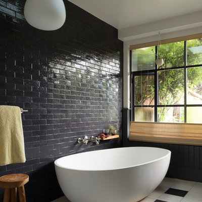 Inspiration for a mid-sized eclectic master black tile and subway tile porcelain tile bathroom remodel in San Francisco with white walls
