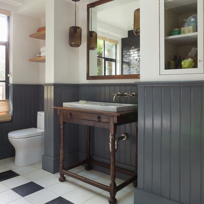 Example of a mid-sized eclectic master black tile and subway tile porcelain tile bathroom design in San Francisco with a console sink, furniture-like cabinets, dark wood cabinets, white walls, wood countertops and brown countertops