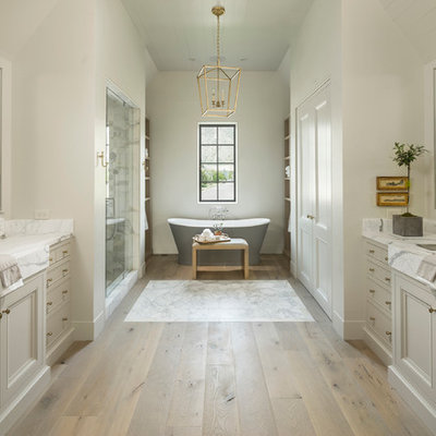 Example of a classic master light wood floor bathroom design in Salt Lake City with gray cabinets, white walls, an undermount sink and recessed-panel cabinets