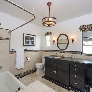 Delightful Tuscan Tub/shower Combo Photo In Miami With Recessed Panel Cabinets And  Black Cabinets