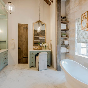 Country master white floor freestanding bathtub photo in Austin with shaker cabinets, turquoise cabinets, beige walls, an undermount sink and white countertops