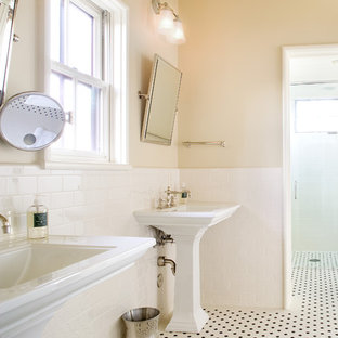 Inspiration for a large traditional master bathroom in Austin with mosaic tile, a pedestal sink, white tile, yellow walls and mosaic tile floors.