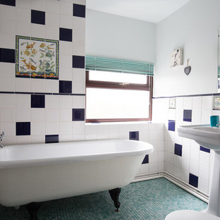This is an example of a small classic shower room in Manchester with a claw-foot bath, blue tiles, white tiles, ceramic tiles, white walls, mosaic tile flooring and a pedestal sink.