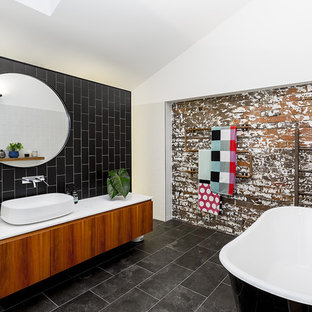 Large industrial bathroom in Sydney with a claw-foot tub, an alcove shower, black tile, ceramic tile, white walls, ceramic floors, marble benchtops, grey floor, an open shower and flat-panel cabinets.