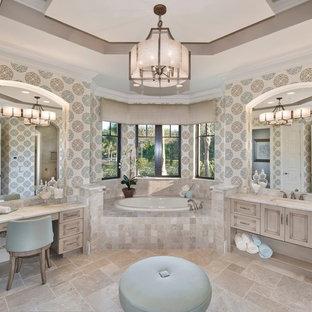 Inspiration pour une grand salle de bain principale méditerranéenne avec un lavabo encastré, un placard avec porte à panneau encastré, un mur multicolore, une baignoire posée, des portes de placard beiges, un sol en travertin, un plan de toilette en marbre, une douche d'angle et un sol beige.