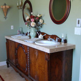 Victorian bathroom in Portland with a drop-in sink, furniture-like cabinets and dark wood cabinets.