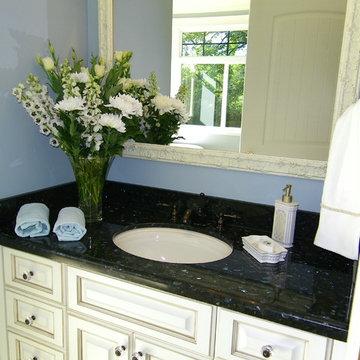Antiqued Cream Bath cabinets