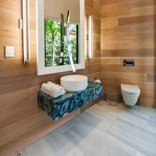 Inspiration for a large contemporary 3/4 bathroom in Miami with a vessel sink, a wall-mount toilet, white tile, brown walls, marble floors, onyx benchtops, grey floor and blue benchtops.