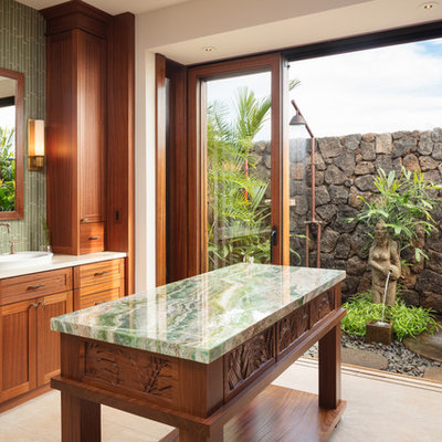 Double shower - large tropical master green tile and glass tile porcelain tile and beige floor double shower idea in Hawaii with shaker cabinets, medium tone wood cabinets, white walls, a vessel sink, quartz countertops and white countertops