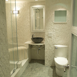 Bathroom - mid-sized transitional 3/4 mosaic tile floor bathroom idea in New York with a vessel sink, a one-piece toilet, white walls and solid surface countertops
