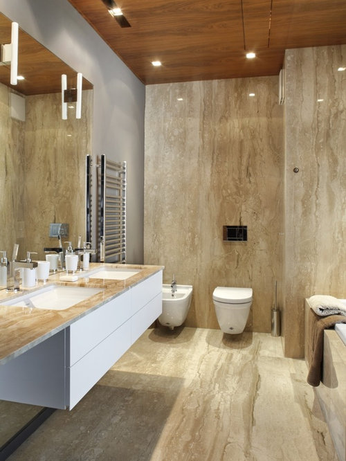 Trendy Bathroom Photo With Marble Countertops, A Wall Mount Toilet And  Marble Tile