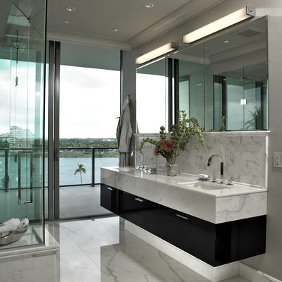 Bathroom - large contemporary master white tile and stone slab bathroom idea in Miami with an undermount sink, flat-panel cabinets, dark wood cabinets and quartzite countertops