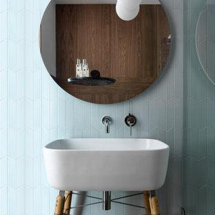 На фото: ванная комната в современном стиле с синей плиткой, консольной раковиной и тумбой под одну раковину с