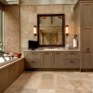 Mountain style beige tile drop-in bathtub photo in Atlanta with a drop-in sink, shaker cabinets and medium tone wood cabinets