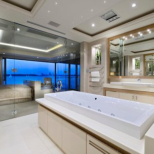 Trendy drop-in bathtub photo in Perth with a drop-in sink and beige walls