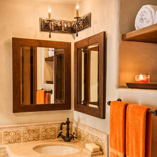 Inspiration for a small mediterranean shower room bathroom in Santa Barbara with open cabinets, dark wood cabinets, marble worktops, a corner shower, a one-piece toilet, beige tiles, ceramic tiles, beige walls and ceramic flooring.