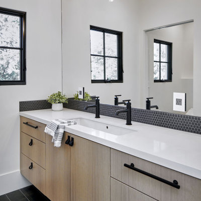 Inspiration for a mid-sized contemporary master black tile and mosaic tile black floor bathroom remodel in San Francisco with flat-panel cabinets, light wood cabinets, white walls, an undermount sink, white countertops and a floating vanity