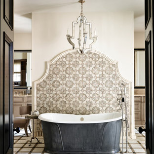 Inspiration for a large mediterranean beige tile ceramic floor freestanding bathtub remodel in Phoenix with white walls