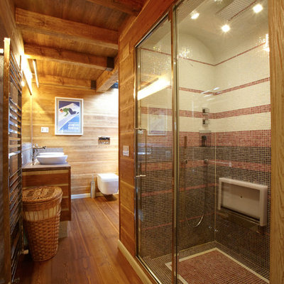 Corner shower - large rustic 3/4 medium tone wood floor corner shower idea in Sydney with medium tone wood cabinets, a wall-mount toilet and a vessel sink