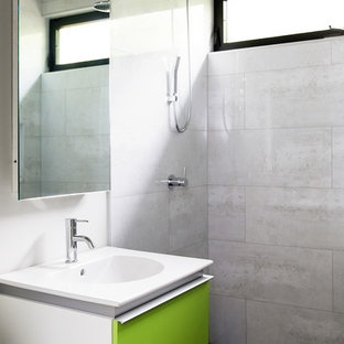 Design ideas for a small contemporary family bathroom in San Diego with flat-panel cabinets, green cabinets, a freestanding bath, a walk-in shower, a wall mounted toilet, white walls, porcelain flooring, an integrated sink, engineered stone worktops, grey floors and an open shower.
