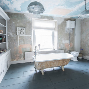 Photo of a large shabby-chic style family bathroom in Other with open cabinets, grey cabinets, a freestanding bath, a two-piece toilet, dark hardwood flooring, wooden worktops, grey floors and an open shower.