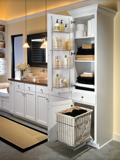 Farmhouse Bathroom by Hager Cabinets Inc.