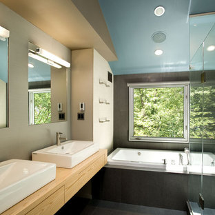 Example of a trendy drop-in bathtub design in DC Metro with a vessel sink