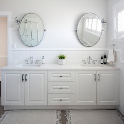 Inspiration for a large timeless master white tile and ceramic tile gray floor bathroom remodel in Brisbane with white cabinets, white walls, an undermount sink, quartz countertops, white countertops and raised-panel cabinets