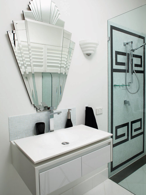 Example Of A Trendy Bathroom Design In Melbourne With Vessel Sink And White Cabinets