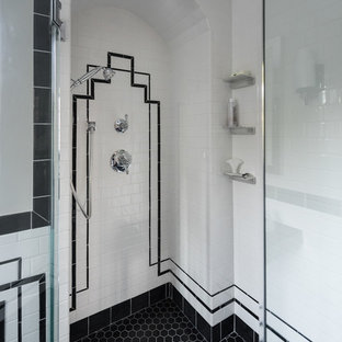 Bathroom - large transitional master black and white tile and ceramic tile porcelain floor and black floor bathroom idea in Providence with open cabinets, a two-piece toilet, gray walls, a console sink, a hinged shower door and black countertops