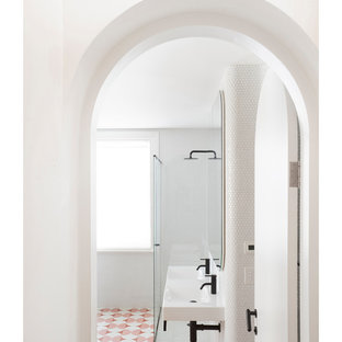 Design ideas for a small scandinavian master bathroom in Melbourne with a freestanding tub, a corner shower, a one-piece toilet, white tile, mosaic tile, white walls, cement tiles, a wall-mount sink, pink floor and a hinged shower door.