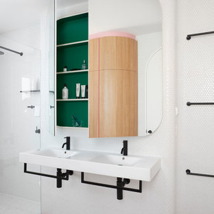 Inspiration for a small scandinavian master bathroom in Melbourne with a freestanding tub, a corner shower, a one-piece toilet, white tile, mosaic tile, white walls, cement tiles, a wall-mount sink, pink floor and a hinged shower door.