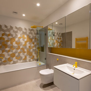 Mid-sized trendy multicolored floor bathroom photo in London with open cabinets, white cabinets, a wall-mount toilet, white walls, a vessel sink, wood countertops, a hinged shower door and beige countertops