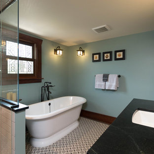 Inspiration for a mid-sized craftsman master black and white tile and porcelain tile mosaic tile floor bathroom remodel in Detroit with shaker cabinets, dark wood cabinets, a two-piece toilet, green walls, an undermount sink and soapstone countertops