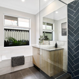 Photo of a mid-sized contemporary master bathroom in Perth with flat-panel cabinets, medium wood cabinets, a corner shower, black tile, porcelain tile, grey walls, porcelain floors, a vessel sink, grey floor, grey benchtops, a single vanity and a built-in vanity.