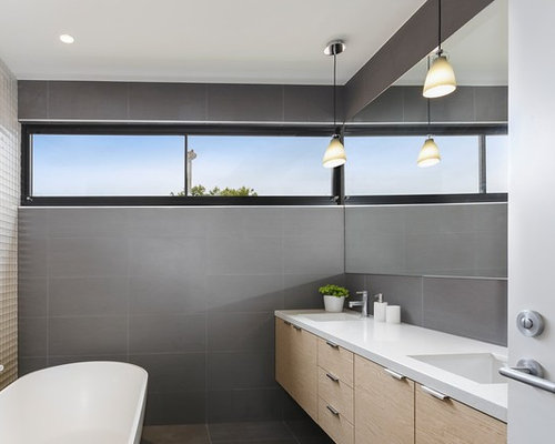 This Is An Example Of A Mid Sized Modern Master Bathroom In Melbourne With  Raised