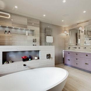 На фото: главная ванная комната среднего размера в стиле современная классика с фасадами в стиле шейкер, фиолетовыми фасадами, отдельно стоящей ванной, душевой комнатой, серой плиткой, серыми стенами, врезной раковиной, серым полом, открытым душем и серой столешницей с