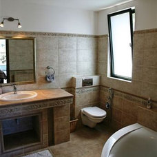 Traditional Bathroom by Asher Elbaz