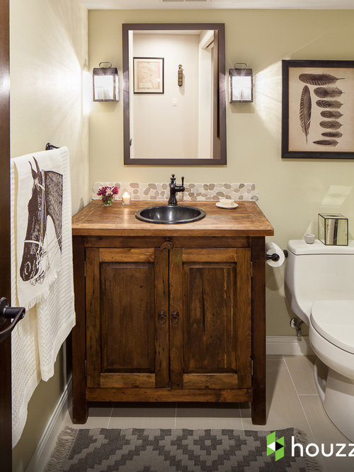 Example of a mountain style beige tile and pebble tile bathroom design in  Other with a. New Bathrooms   Houzz