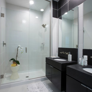 Inspiration for a contemporary alcove shower remodel in Orlando with flat-panel cabinets and black cabinets