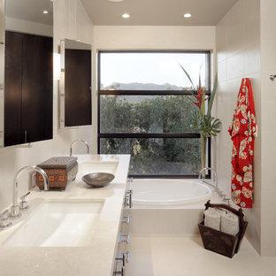 Inspiration for a zen beige tile drop-in bathtub remodel in Phoenix with an undermount sink