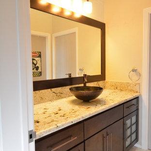 Diseño de cuarto de baño con ducha, de estilo zen, de tamaño medio, con armarios tipo mueble, puertas de armario de madera en tonos medios, baldosas y/o azulejos beige, baldosas y/o azulejos de piedra, paredes amarillas, suelo de travertino, lavabo sobreencimera y encimera de granito