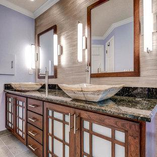 Foto de cuarto de baño principal, asiático, grande, con lavabo sobreencimera, armarios estilo shaker, puertas de armario de madera oscura, encimera de granito, ducha esquinera, sanitario de dos piezas, baldosas y/o azulejos grises, baldosas y/o azulejos de cerámica, paredes púrpuras y suelo de baldosas de cerámica