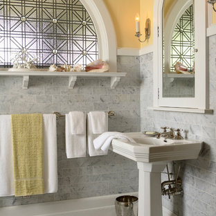 Bathroom - traditional master gray tile and stone tile marble floor and multicolored floor bathroom idea in Minneapolis with a pedestal sink and yellow walls