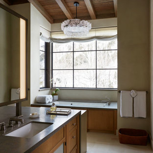 Photo of a country master bathroom in Other with recessed-panel cabinets, medium wood cabinets, beige walls, an undermount sink, beige floor, grey benchtops, a built-in vanity, exposed beam, vaulted and wood.