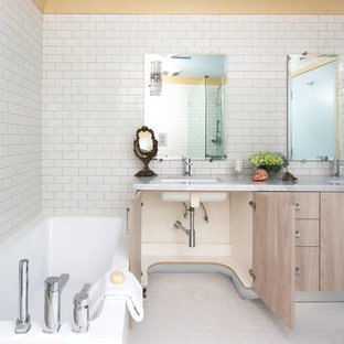 Transitional white tile and ceramic tile bathroom photo in Los Angeles with an undermount sink, flat-panel cabinets, marble countertops, a one-piece toilet and light wood cabinets