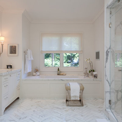 Example of a large trendy white tile and marble tile marble floor alcove shower design in San Francisco with an undermount sink, white cabinets, marble countertops, an undermount tub and white walls