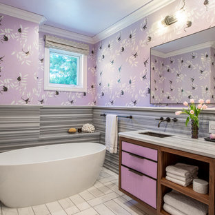 Contemporary kids bathroom in San Francisco with purple cabinets, a freestanding tub, gray tile, an undermount sink, grey benchtops, a double vanity, a built-in vanity and wallpaper.