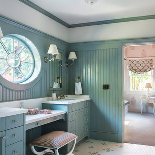 Example of a mid-sized transitional gray tile porcelain floor, multicolored floor and wall paneling bathroom design in San Francisco with blue cabinets, blue walls, an undermount sink, solid surface countertops, shaker cabinets and a built-in vanity